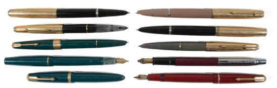 A large collection of various vintage fountain pens