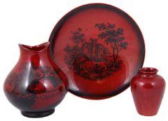 A Royal Doulton flambé 'Woodcut' vase, dish and another