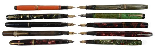 A large collection of early to mid 20th c mottled and plain fountain pens and propelling pencils