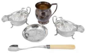 A pair of George V silver sauce boats and ladles, a christening mug and a dish