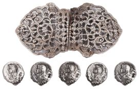 A set of five Edward VII Art Nouveau silver buttons and a late Vict. silver nurses' buckle