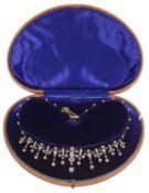 An exquisite Edwardian diamond necklace converting to a tiara,