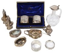 A mixed lot of silver to include an Edwardian Art Nouveau five piece cruet set and napkin rings