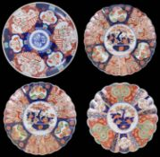 A pair of late 19th century Japanese Imari chargers and two others
