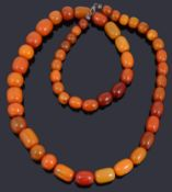 A single row graduated amber bead necklace