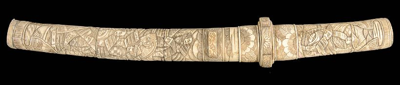 A late 19th/early 20th century Japanese carved bone tanto