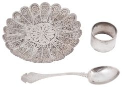 An Islamic white metal filigree dish, possibly Sudanese and other silver items