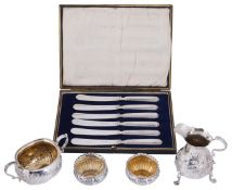 A George II silver cream jug and later silver items