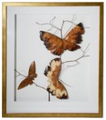 A contemporary wooden picture of three butterflies on a branch