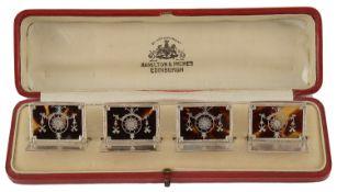 A set of four George V silver and tortoiseshell menu card holders