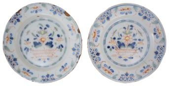 A pair of mid 18th century English polychrome Delft plates