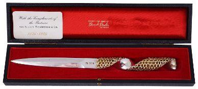 A Stuart Devlin silver and parcel gilt paper knife