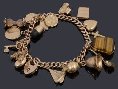 A 9ct gold charm bracelet with padlock and assorted gold charms
