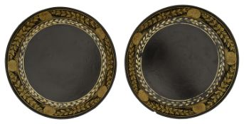 A pair of George III black japanned and gilt decorated papier mache bottle coasters c.1800