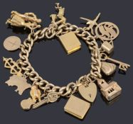 A 9ct gold hollow curb link bracelet with padlock and seventeen assorted gold charms