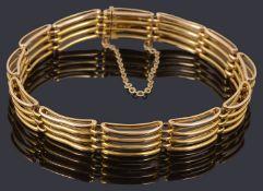A gold four row gate link bracelet