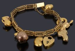 A 9ct gold three row charm bracelet with padlock and nine assorted charm and another loose charm
