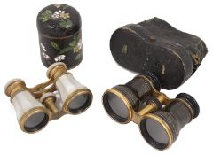 Two pairs of late 19th century gilt metal opera glass