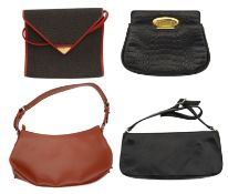 A collection of four designer handbags