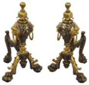 A pair of large late Victorian polished steel and brass andirons