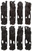 An early 20th century set of eight Chinese carved hardwood Dhaoist Immortals