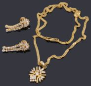 An Indian high carat gold pendant on chain and similar earrings