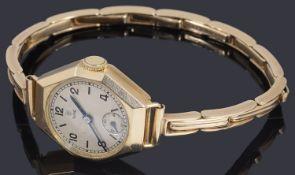 A ladies 9ct gold Tudor mechanical bracelet watch