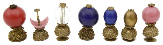 A collection of seven 19th century Qing dynasty Mandarin gilt metal and Peking glass hat buttons