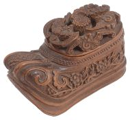 A 19th century Chinese Qing dynasty carved coquilla nut shoe shaped snuff box