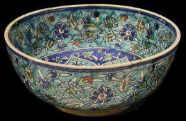 A large 19th century Iznik pottery polychrome tin glazed bowl