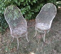 Two late 19th/early 20th century white painted wirework garden/ conservatory armchairs