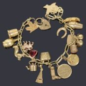 A charm bracelet mark 585 with padlock and assorted charms
