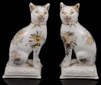 A pair of early 19th century Staffordshire pottery cats