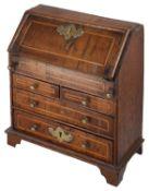 A 19th century George II style miniature walnut and oak bureau