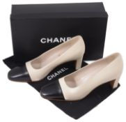 A pair of Chanel two tone leather court heel shoes
