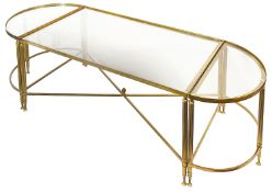 A lacquered brass and smokey glass set of three low occasional tables