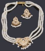 An Indian freshwater pearl necklace and matching earrings