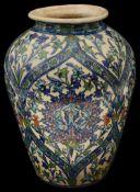 A large 19th century Iznik pottery polychrome tin glazed vase