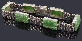 A white metal and jade panel bracelet