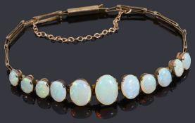 A delicate Edwardian graduated opal centrepiece bracelet