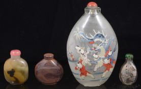 A large early 20th century Chinese inside painted glass snuff bottle and three others