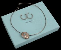 A Tiffany & Co silver shell pendant necklace
