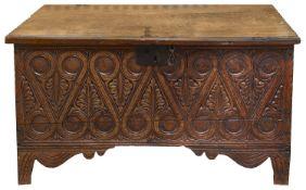 A 17th century carved oak six plank coffer