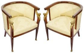 A pair of late French Empire style mahogany framed tub armchairs with ormolu mounts c.1900