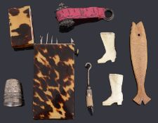 An early 19th century tortoiseshell crochet etui and other sewing items