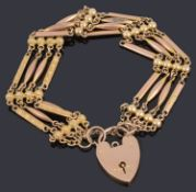 A Victorian gold four row fancy link bracelet with padlock