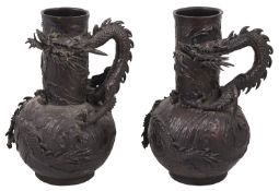 A pair of Japanese Meiji period bronze dragon vases