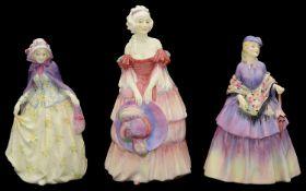Three pre war Royal Doulton porcelain figures