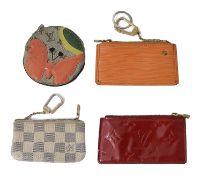 Four assorted Louis Vuitton coin purses