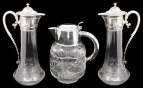 A pair of early 20th c Polish cut glass claret jugs with silver plated mounts and a lemonade jug